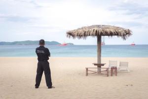 Police and a beach Sri Lanka