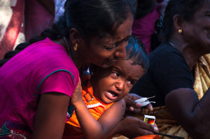 Mullivaikal Remembrance 18 May 2015. Grieving war widow and child.